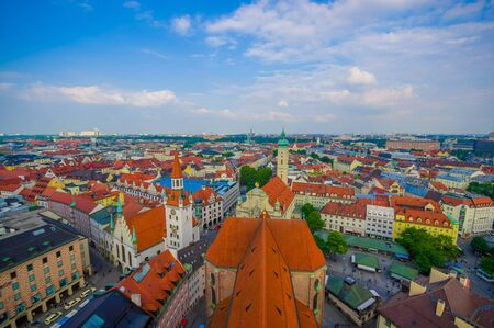 strecthing: Munich, Germany - July 30, 2015: Beautiful overview over city taken from high up, showing rooftops strecthing far as eye can see, sunny blue skies. Editorial