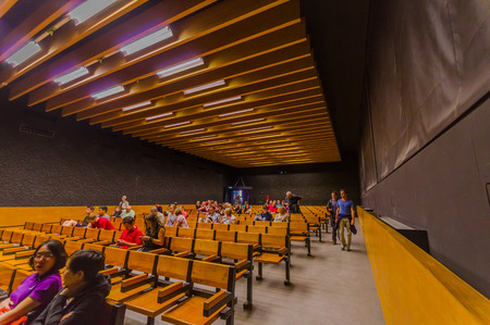 sachsenhausen: Dachau, Germany - July 30, 2015: Simple classroom with wooden benchchairs in lines, part of museum inside concentration camp.