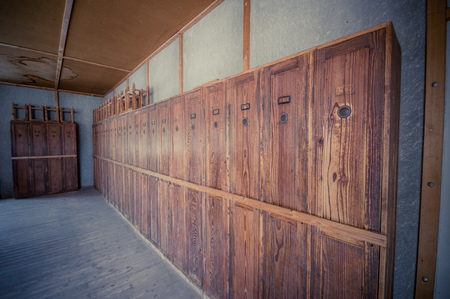 sachsenhausen: Dachau, Germany - July 30, 2015: Personal lockers inside barracks for prisoners to store private belongings, still in its original state. Editorial