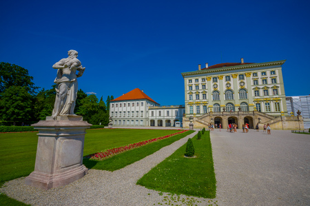 nymphenburg palace: Nymphenburg, Germany - July 30, 2015: Beautiful palace as seen from distance with statues on both sides of avenue leading up to building. Editorial