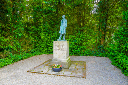 sachsenhausen: Dachau, Germany - July 30, 2015: Statue of the unknown inmate made by artist Nandor Glid at concentration camp. Editorial