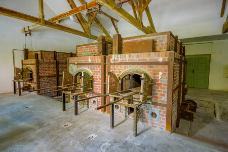 sachsenhausen: Dachau, Germany - July 30, 2015: Brick ovens inside crematorium building showing gruesome reality of what happened at concentration camps.