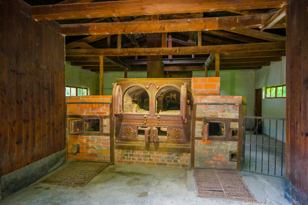 sachsenhausen: Dachau, Germany - July 30, 2015: Brick ovens inside the old crematorium building showing gruesome reality of what happened at concentration camps. Editorial