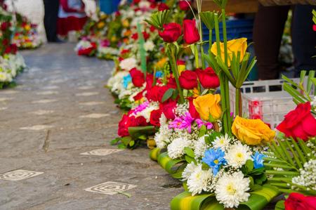 sidewalk sale: Cuenca, Ecuador - April 22, 2015: Beauitful colourful flower bouquet arrangements for sale along sidewalk.