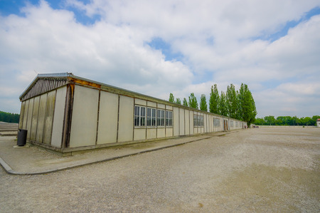 sachsenhausen: Dachau, Germany - July 30, 2015: Outside view long barrack building. part of concentration camp installations.