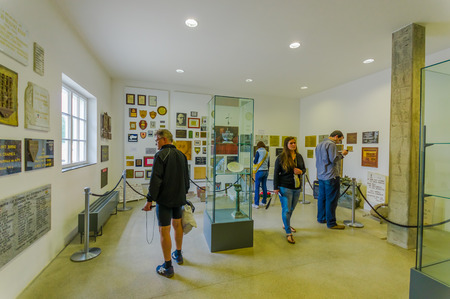 Dachau, Germany - July 30, 2015: Random people looking around inside museum building at concentration camp. Editorial