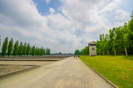 german fascist: Dachau, Germany - July 30, 2015: Inside concentration camp with guard towers visible, outdoors marching area for prisoners.