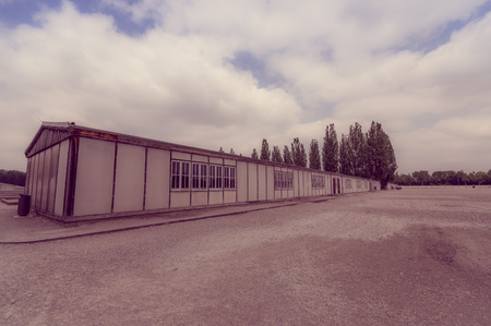 documented: Dachau, Germany - July 30, 2015: Outside view long barrack building. part of concentration camp installations.