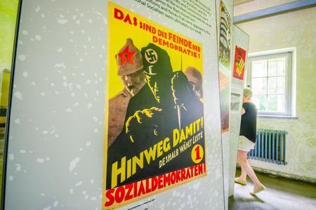 Dachau, Germany - July 30, 2015: Nazi propaganda poster from world war 2 found inside museum of concentration camp.