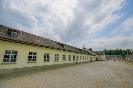 documented: Dachau, Germany - July 30, 2015: Outside view long barrack building, part of concentration camp installations. Editorial