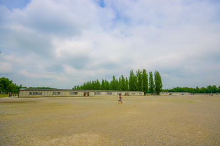 oppressed: Dachau, Germany - July 30, 2015: Large open gravel square inside concentration camp, barracks and administration buildings sorrounding. Editorial