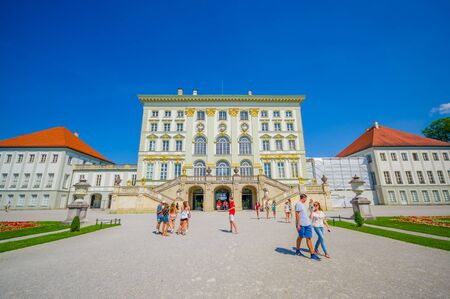 nymphenburg palace: Nymphenburg, Germany - July 30, 2015: Beautiful palace building as seen from outside front view, royal architecture with golden decorations on facade. Editorial