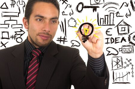 writing on screen: young handsome businessman drawing light bulb on whiteboard with marker concept of bright idea inspiration creativity Stock Photo