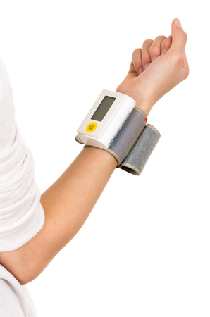 selfcontrol: Right arm vertically wearing glucose meter around wrist with white background. Stock Photo