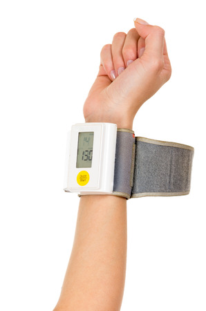 glycemic: Right arm vertically wearing glucose meter around wrist with white background. Stock Photo