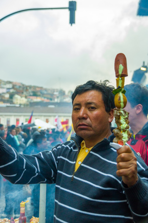 demonstrations: Quito, Ecuador - August 27, 2015: Man selling barbecue skewers in city streets during anti government mass demonstrations.