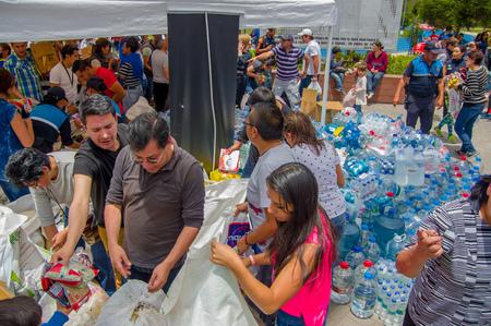fema: Quito, Ecuador - April,17, 2016: Unidentified citizens of Quito providing disaster relief food, clothes, medicine and water for earthquake survivors in the coast. Gathered at la Caolina Park.