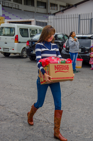 sent: Quito, Ecuador - April,17, 2016: Unidentified citizens of Quito donating disaster relief items, food, clothes, medicine and water for earthquake survivors in the coast.
