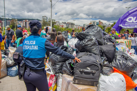 humanitarian aid: Quito, Ecuador - April,17, 2016: Unidentified citizens of Quito providing disaster relief food, clothes, medicine and water for earthquake survivors in the coast. Gathered at la Caolina Park.