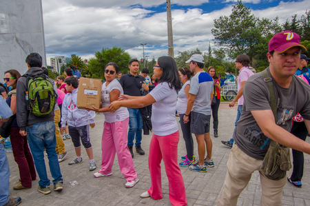 Quito, Ecuador - April,17, 2016: Unidentified citizens of Quito providing disaster relief food, clothes, medicine and water for earthquake survivors in the coast.