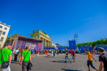 champions league: BERLIN, GERMANY - JUNE 06, 2015: Blue advertisings all around Brandenburger gate of Champions league final match in Berlin, people just celebrating