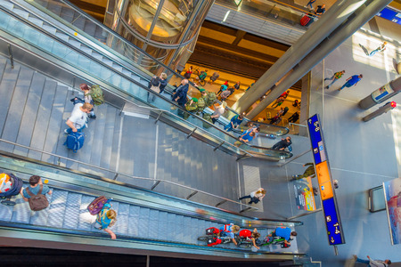 steps and staircases: BERLIN, GERMANY - JUNE 06, 2015: Long electrical stairs in train station, people going up and down