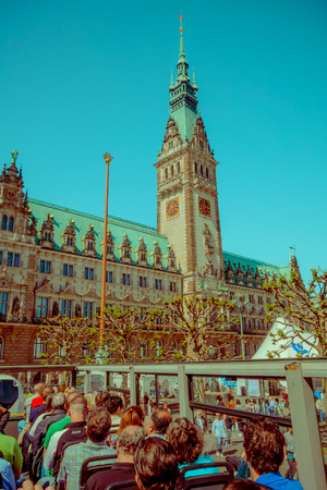 drop off: HAMBURG, GERMANY - JUNE 08, 2015: City hall view from a drop on and drop off bus, emblematic buiding. Clock in the middle,