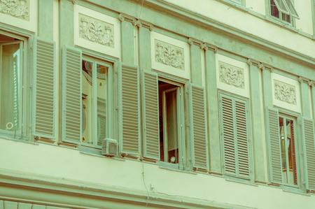 bad color: FLORENCE, ITALY - JUNE 12, 2015: Old green open windows in an old building, pinturesque and historic objects. Editorial