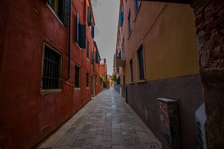 the merchant of venice: VENICE, ITALY - JUNE 18, 2015: Venice narrow streets in a pinturesque neigborhood, nobody on the view. Editorial
