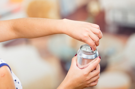 aluminum cans: pretty brunette and an blank soda on a restaurant Stock Photo