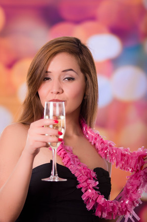 after the party: Drunk face woman holding a champagne cup, after party. Colored background, Stock Photo