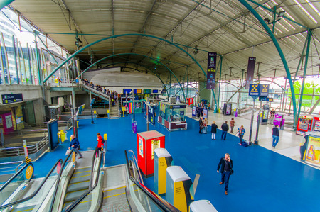 france station: Lille, France - June 3, 2015: Inside main room railroad station Lille Europe, travellers walking around.