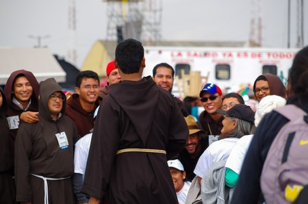 priests: QUITO, ECUADOR - JULY 7, 2015: In pope mass event, priests group with people trying to get a nice photo.