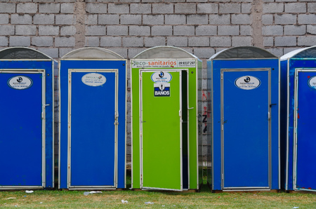latrine: QUITO, ECUADOR - JULY 7, 2015: Eco portable toiletes in blue and green color, public events needs. Editorial