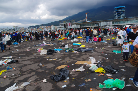 getting out: QUITO, ECUADOR - JULY 7, 2015: Pope Francisco event in Quito, after mass people getting out. Garbage on the floor.