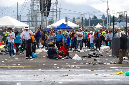 tends: QUITO, ECUADOR - JULY 7, 2015: After pope Francisco mass event, people trying to get out. Rainning is comming, tends on the street.