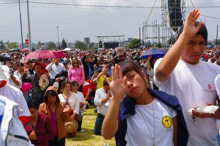 blessings: QUITO, ECUADOR - JULY 7, 2015: People raising the hand to receive blessings, pope Francisco mass event.