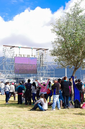 big screen: QUITO, ECUADOR - JULY 7, 2015: Big screen at pope Francisco mass, people far from him can see. Road inside mass.