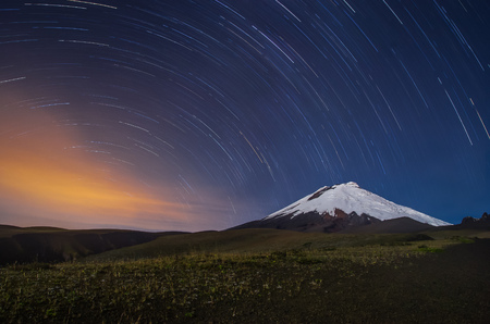 The Cotopaxi volcano in Ecuador, night shot with star trails. Stock Photo