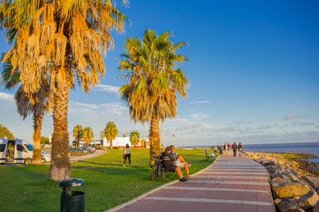 MONTEVIDEO, URUGUAY - MAY 04, 2016: people spending some free time at a park located in front of the beach.