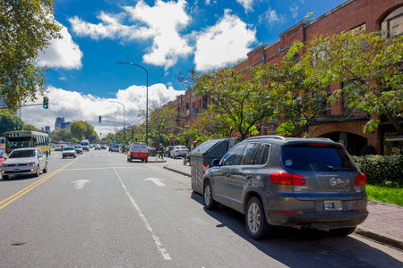 sidewalks: BUENOS AIRES, ARGENTINA - MAY 02, 2016: car parked in a nice street on a sunny day.