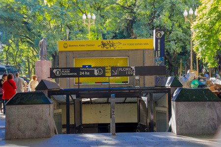 subway entrance: BUENOS AIRES, ARGENTINA - MAY 02, 2016: Subway entrance located in a park, sorrounded by a lot of trees and close to a statue . Editorial