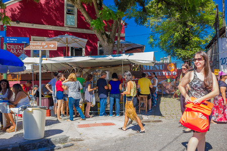 sunday market: CURITIBA ,BRAZIL - MAY 12, 2016: unidentified people buying some food at a little stand located in a corner close to the city market.