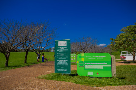 CURITIBA ,BRAZIL - MAY 12, 2016: welcome sign at the entrance of the botanic garden next to a informative banner.