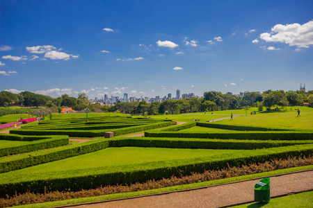 CURITIBA ,BRAZIL - MAY 12, 2016: nice geometrical shapes in the garden of the botanical park withe the skyline of the city as background.