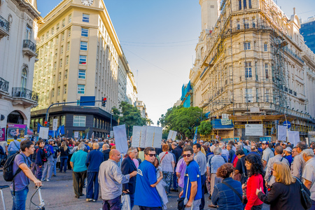 layoffs: BUENOS AIRES, ARGENTINA - MAY 02, 2016: unidentified people marching and protesting on the street against the massive layoffs. Editorial