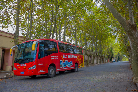 turistic: COLONIA DEL SACRAMENTO, URUGUAY - MAY 04, 2016: the city bus tour offers a ride trough the city and all the main turistic places.