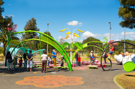 inner city: QUITO, ECUADOR - 8 AUGUST, 2016: Artistic design public playground with variations of activities, located in inner city park La Carolina, beautiful sunny day.