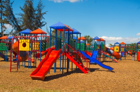 inner city: QUITO, ECUADOR - 8 AUGUST, 2016: Colorful public playground towers with tunnels and slides, located in inner city park La Carolina, beautiful sunny day.