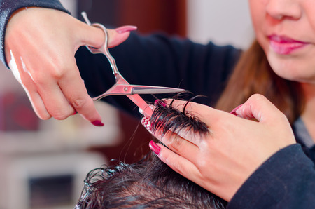 How to make a nice haircut, hair between fingers and scissors.